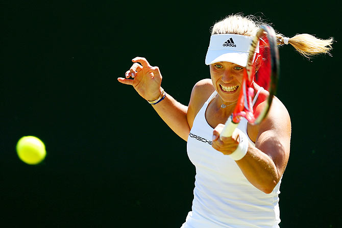 Germany's Angelique Kerber plays a forehand in her first round match against compatriot Carina Witthoeft