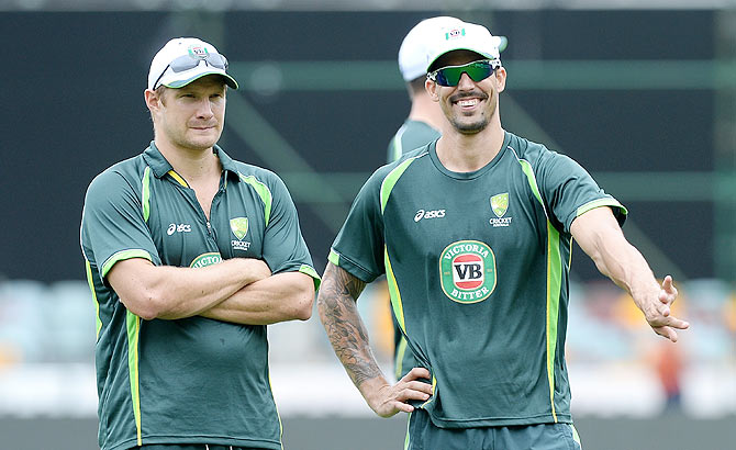 Shane Watson and Mitchell Johnson share a laugh during an Australian training session