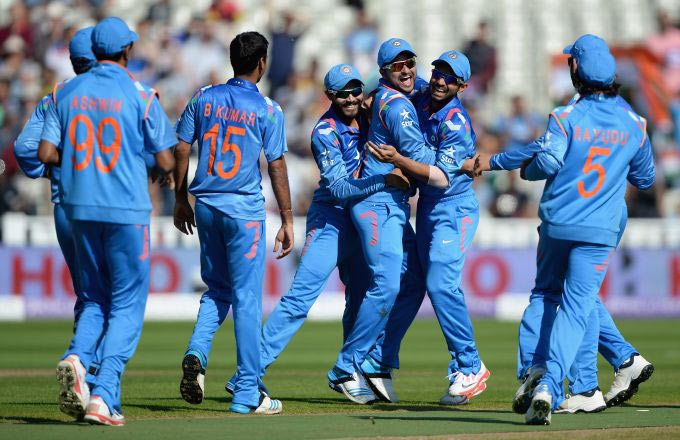The Indian team celebrates after claiming a wicket