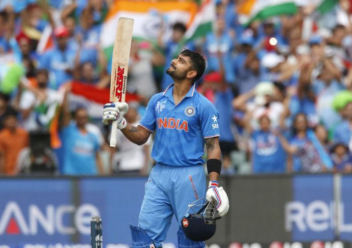 Virat Kohli looks to the sky after scoring a century during the World Cup match against Pakistan in Adelaide