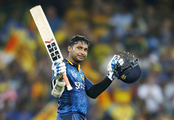 Sri Lanka's Kumar Sangakkara celebrates reaching his century against Australia during their Cricket World Cup match in Sydney on Sunday