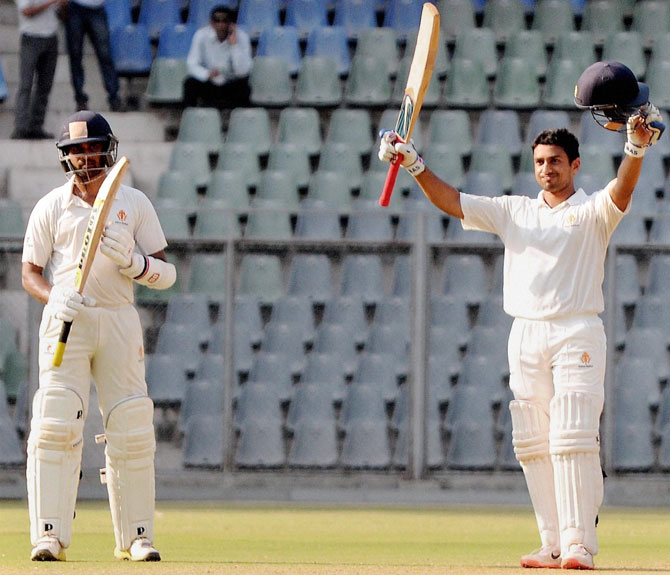 K L Rahul applauds after Karun Nair gets to a hundred during their partnership in the Ranji Trophy final against Tamil Nadu