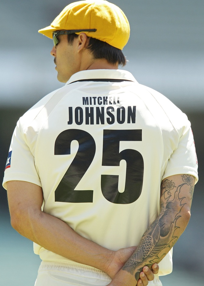 A tattoo adorns the arm of Mitchell Johnson