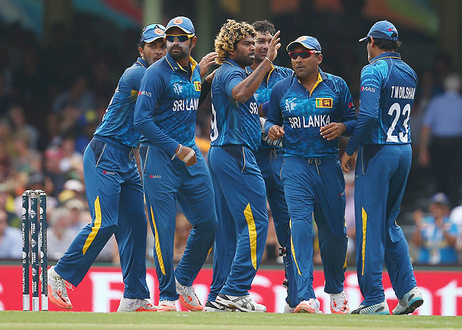 Lasith Malinga of Sri Lanka celebrates with his teammates after claiming a wicket