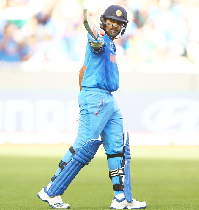 Rohit Sharma celebrates his century against Bangladesh at the Melbourne Cricket Ground, March 19, 2015. Photograph: Robert Cianflone/Getty Images.