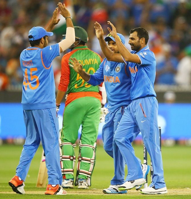Mohammed Shami and his team-mates celebrate Bangladesh star Mohammad Mahmudullah's wicket. Photograph: Robert Cianflone/Getty Images