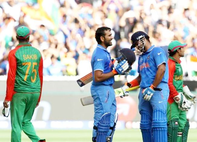 India's Rohit Sharma and Suresh Raina during the World Cup quarter-final against Bangladesh at the MCG