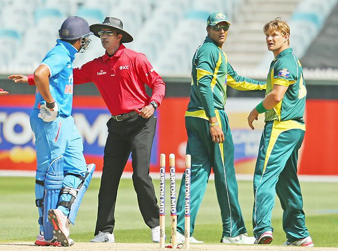 Shane Watson of Australia and Rohit Sharma of India exchange words