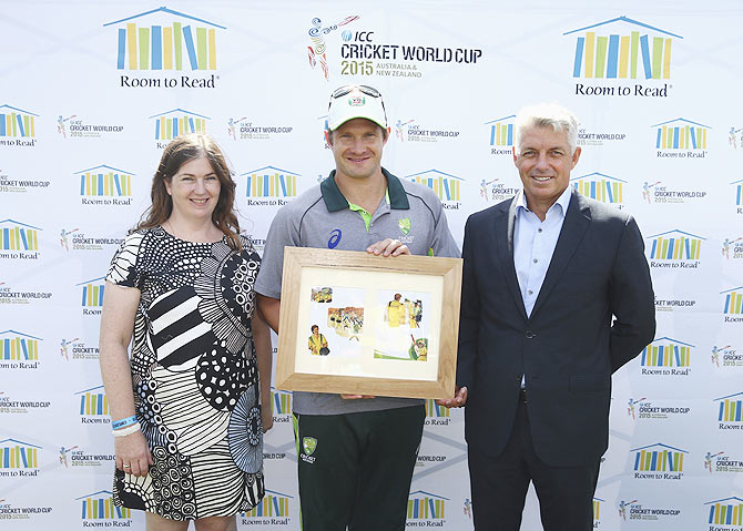 Chantal Lewis, Director Room to Read Australia, Shane Watson of Australia and Dave Richardson, CEO of ICC pose during a book launch at the Sydney Cricket Ground on Wednesday