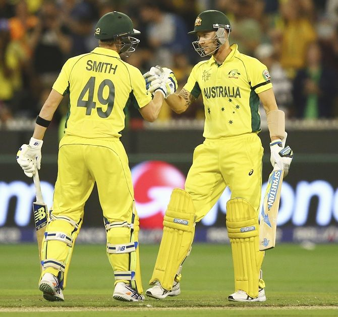 Steve Smith congratulates Michael Clarke after the skipper scored his half century. Photograph: Ryan Pierse/Getty Images