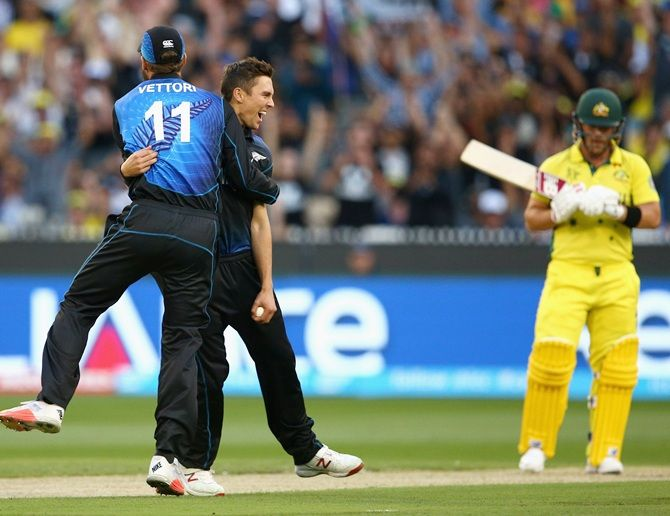 Trent Boult celebrates with Daniel Vettori after dismissing Aaron Finch. Photograph: Cameron Spencer/Getty Images