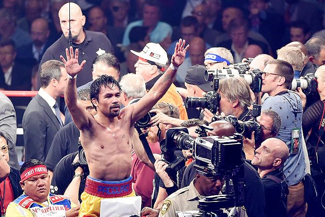Manny Pacquiao gestures to the crowd after losing to Floyd Mayweather Jr.