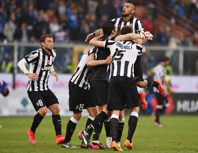 Players of Juventus FC celebrate after beating UC Sampdoria 1-0 to win the Serie A Championships at the end of the Serie A match at Stadio Luigi Ferraris in Genoa, Italy, on Saturday