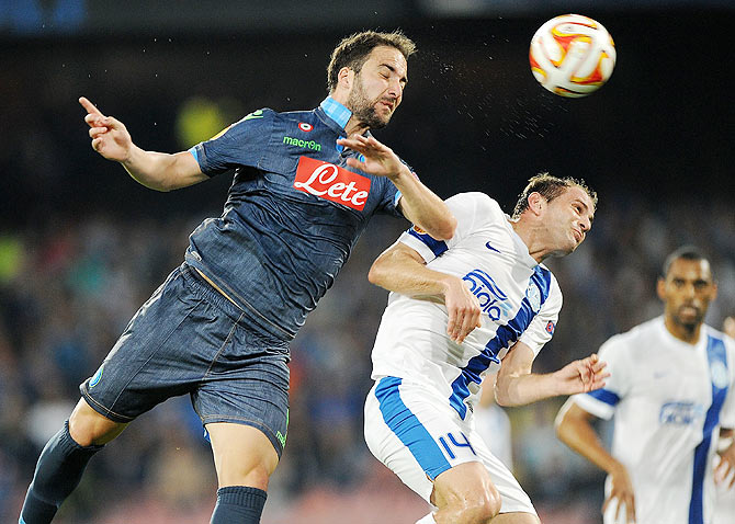 Napoli's player Gonzalo Higuain vies with FC Dnipro Dnipropetrovsk's Yevhen Cheberyachko during their UEFA Europa League first leg semi-final in Naples on Thursday