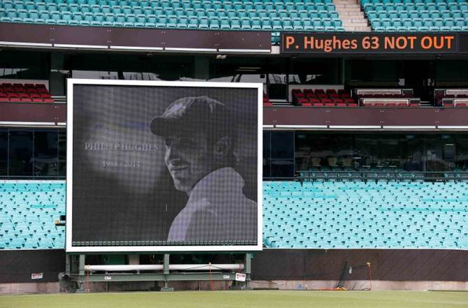 A scoreboard and side screen displays tributes to Phillip Hughes at the Sydney Cricket Ground on December 3, 2014