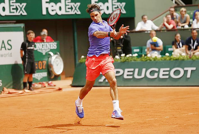 Switzerland's Roger Federer in action against Colombian Alejandro Falla during the men's singles first round match of the French Open