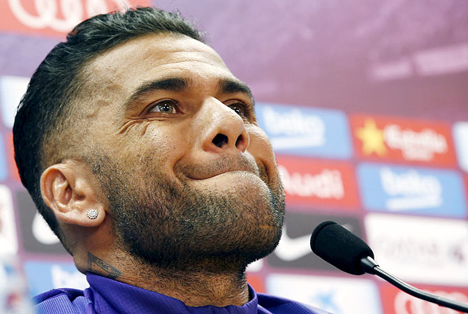 Barcelona's Dani Alves at a press conference on Monday