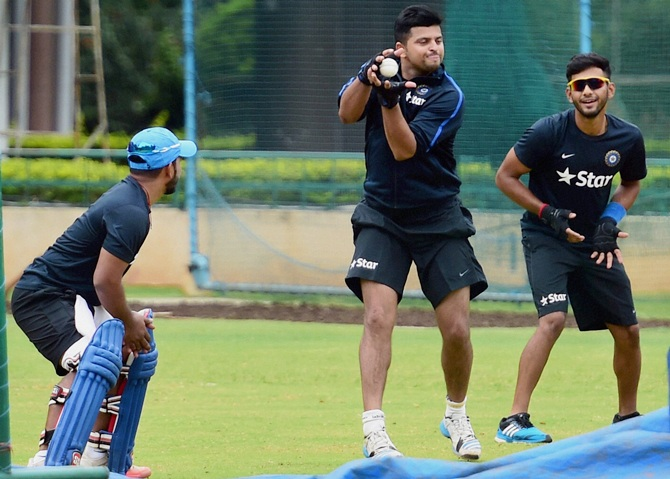 India's Suresh Raina, centre, Unmukt Chand, right, and Kedar Jadhav during a practice session