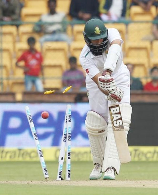 South Africa's captain Hashim Amla is bowled by India's Varun Aaron
