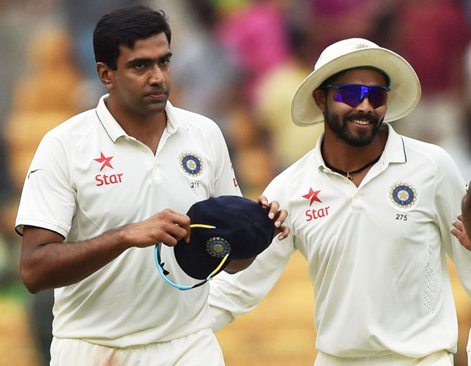 India's Ravichandran Ashwin and Ravindra Jadeja return to the pavilion after the end of the South Africa's firdy innings on Saturday