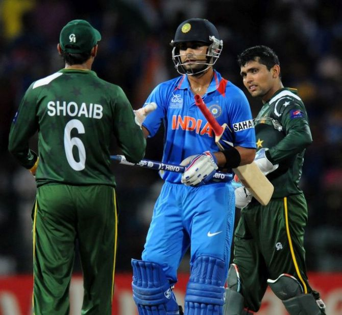 India's Virat Kholi is congratulated by Shoaib Malik of Pakistan after a game