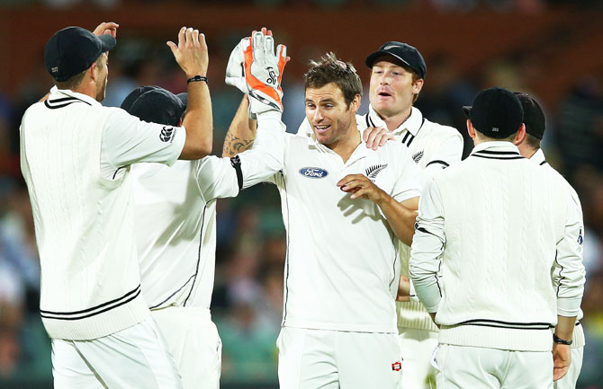 New Zealand's Doug Bracewell celebrates dismissing Australia's Joe Burns on Day 1 of the Third Test at Adelaide Oval in Adelaide on Friday