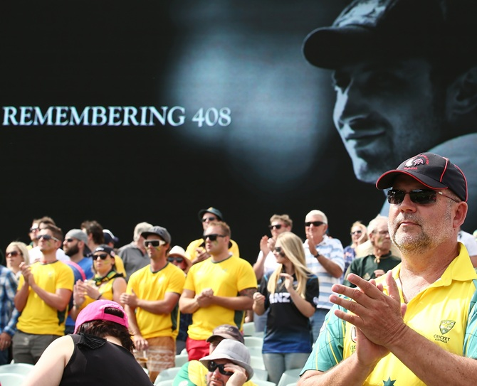 Spectators pay tribute to former cricketer Phillip Hughes