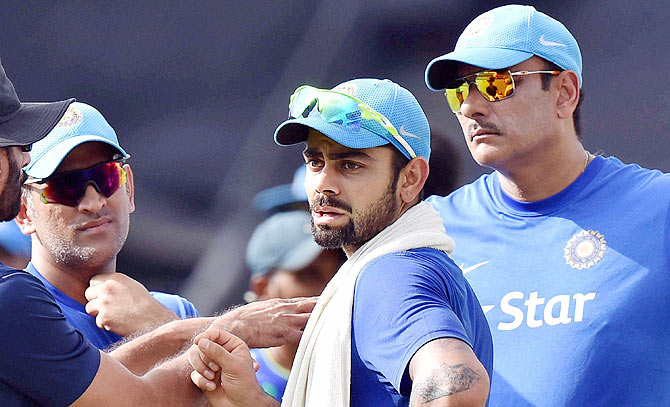 Mahendra Singh Dhoni, Virat Kohli and Team Director Ravi Shastri during a training session at the Eden Garden in Kolkata ahead of the 3rd T20 game against South Africa, October 8, 2015. Photograph: Ashok Bhaumik/PTI