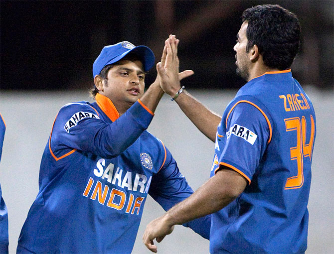 India's Suresh Raina and Zaheer Khan (right) celebrate a dismissal
