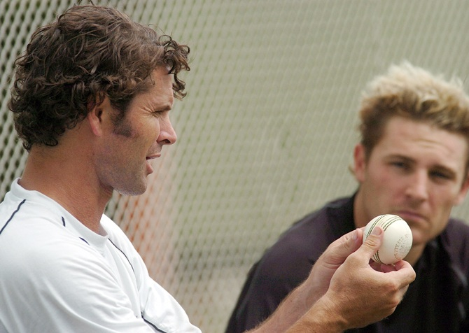 Brendon McCullum, right, watches Chris Cairns
