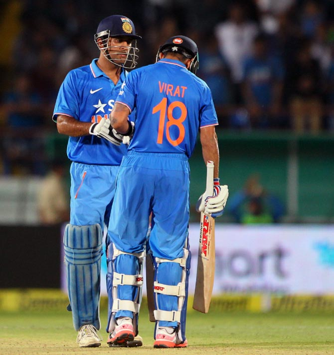 India's Captain Mahendra Singh Dhoni with Virat Kohli in the third ODI in Rajkot, October 18.