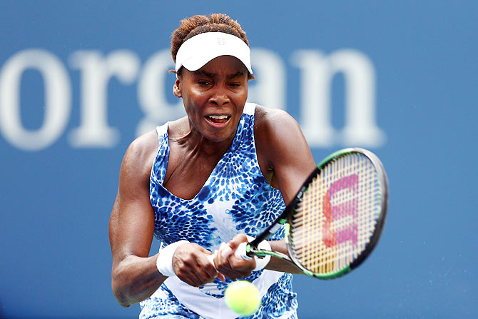 USA's Venus Williams  returns a shot against Puerto Rico's Monica Puig during their first round match on Monday