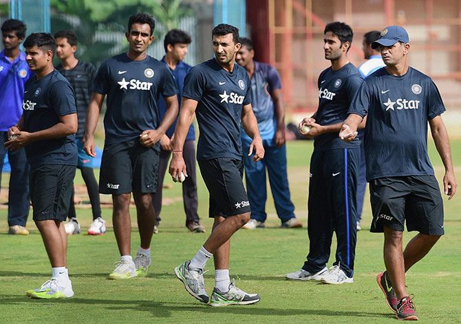 Coach Rahul Dravid, extreme right, with India 'A' team members Jayant Yadav, Rishi Dhawan, Gurkeerat Mann and Karan Sharma during a training session ahead of the ODI series against Bangladesh 'A' at the National Cricket Academy in Bengaluru. Photograph: PTI