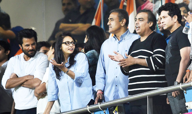 Indian batting maestro Sachin Tendulkar (extreme right) watches the match along with industrialist Mukesh Ambani (2nd from right), politician Praful Patel (3rd from right) and Bollywood star Anil Kapoor (left)