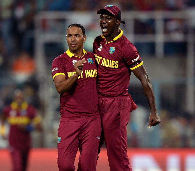 West Indies Captain Darren Sammy with leg-spinner Samuel Badree. Photograph: Getty Images