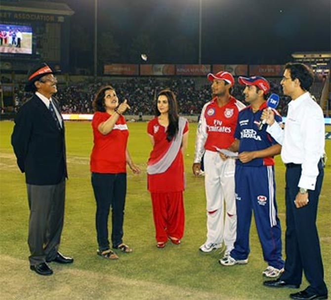 Harsha Bhogle, right, at the toss before an IPL game.