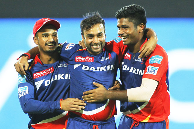 The Delhi Daredevils' Amit Mishra, Pawan Negi and Sanju Samson celebrate the wicket of Kings XI Punjab's Glenn Maxwell on Friday