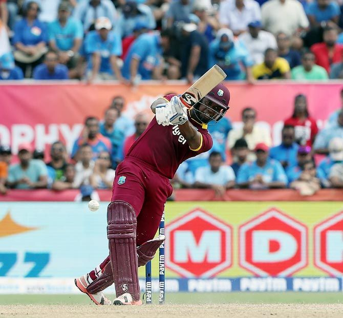 Evin Lewis hits out against India. Photograph: BCCI