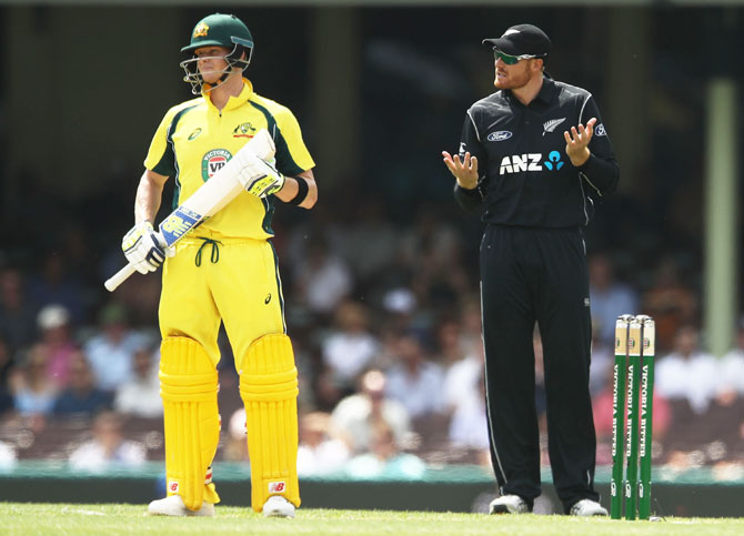 Australia captain Steven Smith watches on as New Zealand's Martin Guptill questions the bolwer for a review during the first One Day International at Sydney Cricket Ground on Sunday