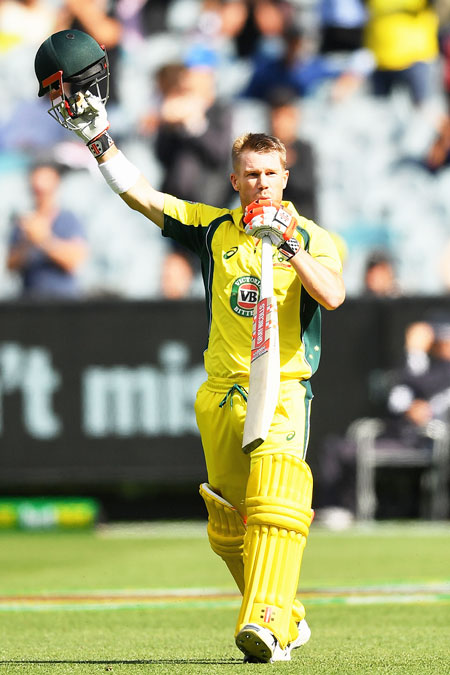 Australia's David Warner celebrates making a century during the 3rd ODI against New Zealand at Melbourne Cricket Ground on Friday