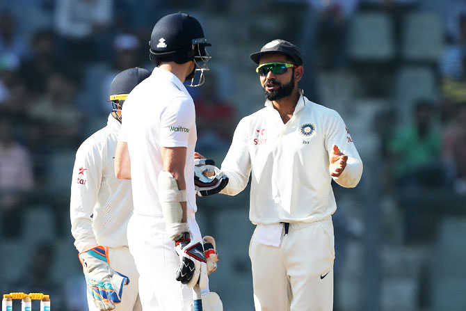 Virat Kohli talks to Jamie Anderson, asking for calm, on Day 5 of the 4th Test in Mumbai on Monday