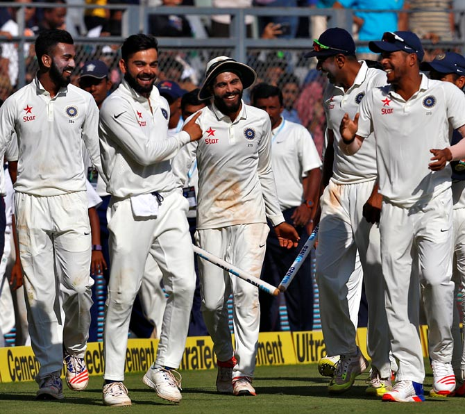 The Indian players celebrate winning the fourth Test in Mumbai on Monday