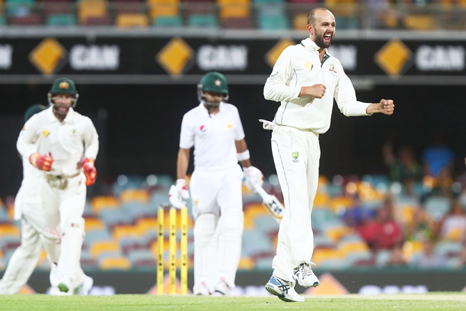 Australia's Nathan Lyon celebrates dismissing Pakistan's Babar Azam on Day 3 of the first Test match at The Gabba in Brisbane on Saturday