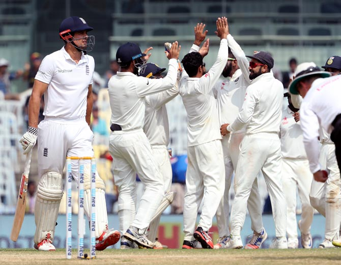India's players celebrate as Alastair Cook walks back after his dismissal on Day 5 of the 5th Test in Chennai on Tuesday