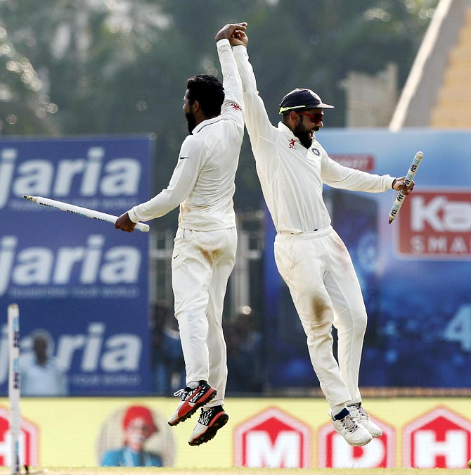 Virat Kohli, right, and Ravindra Jadeja celebrate winning the fifth and final Test in Chennai.