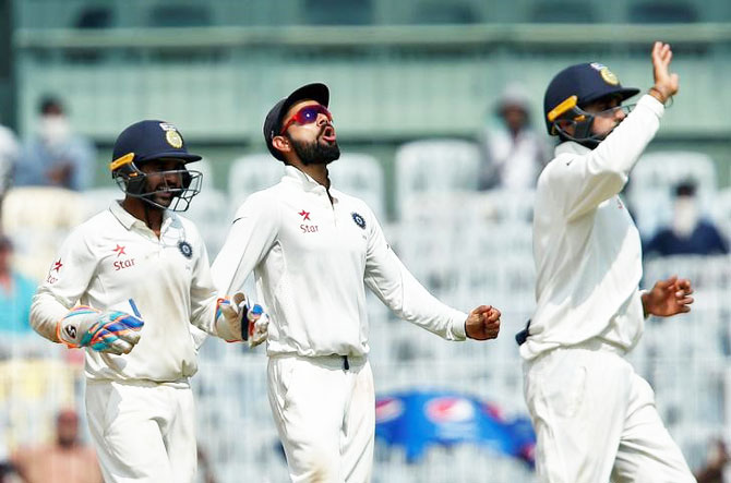India's captain Virat Kohli celebrates with teammates after England's Keaton Jennings was caught and bowled by Ravindra Jadeja