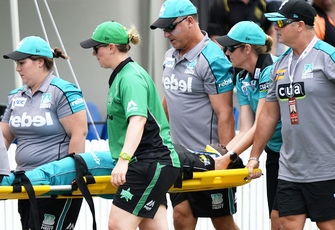 Deandra Dottin of the Brisbane Heat is taken from the field injured after colliding with teammate Laura Harris during their WBBL match against Melbourne Stars at Allan Border Field in Brisbane on Tuesday