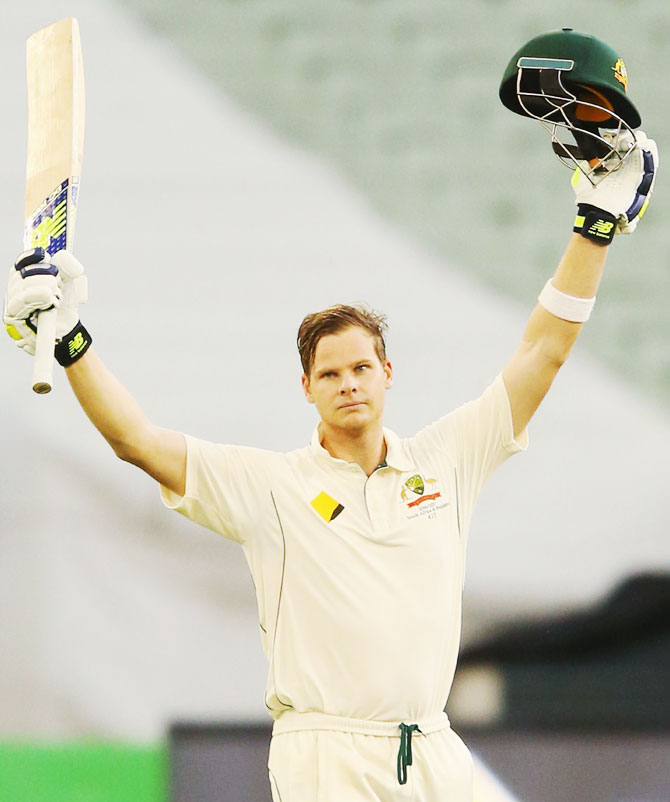 Australia's Steve Smith celebrates on completing a century against Pakistan on Day 4 of the second Test at Melbourne Cricket Ground in Melbourne on Thursday