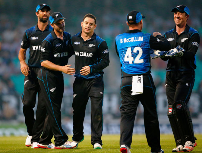 New Zealand's Nathan McCullum celebrates a wicket with teammates