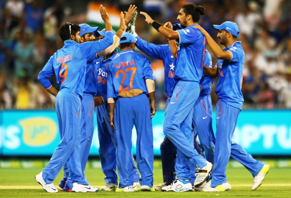 Indian players celebrate the fall of an Australian wicket